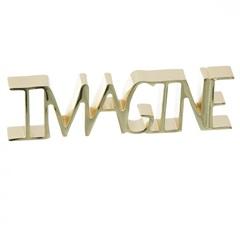 Escultura em Metal Imagine 8,89x17,78cm Dourado - Casa Etna